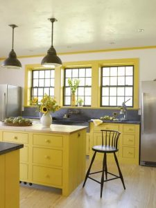 . Bright Yellow Kitchen Including Soapstone and Butcher Block Countertops